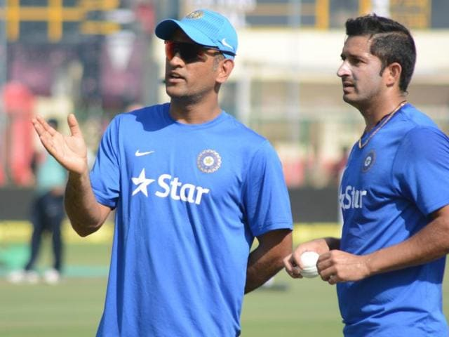 Dhoni and Mohit Sharma during a practice session at Green Park in Kanpur.