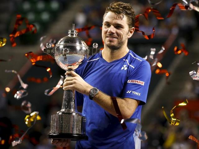 Switzerland's Stan Wawrinka, right, and Benoit Paire of France hold their trophies after the final of the Japan Open in Tokyo, on October 11, 2015.