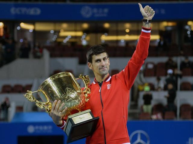 Novak Djokovic of Serbia hits a return against Rafael Nadal of Spain during their men's singles final match at the China Open tennis tournament in Beijing.
