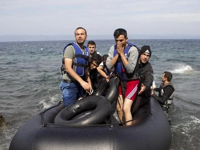 Afghan refugees arrive on a dinghy on the Greek island of Lesbos, after crossing a part of the Aegean Sea from the Turkish coast.