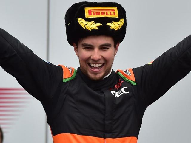 Sahara Force India F1 Team's Mexican driver Sergio Perez celebrates his third-place finish at the Russian Grand Prix at the Sochi Autodrom circuit on October 11, 2015.