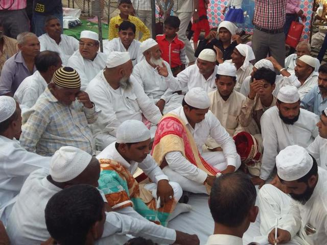 Villagers of Bisada at the wedding of two Muslim girls on Sunday. Hindus arranged the food for the lunch.