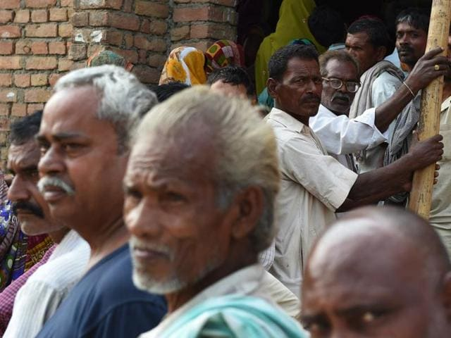 Voters queue to cast their ballots in the village of Banbira in Samastipur district.