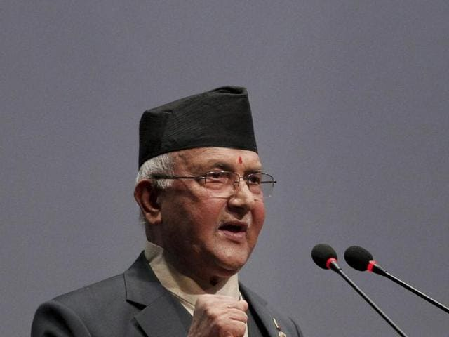 Nepal's newly-appointed prime minister Khadga Prasad Oli, left, waves to the media as he stands with other leaders of Communist Party of Nepal (Unified Marxist–Leninist), also known as CPN-UML, inside the Constituent Assembly in Kathmandu.