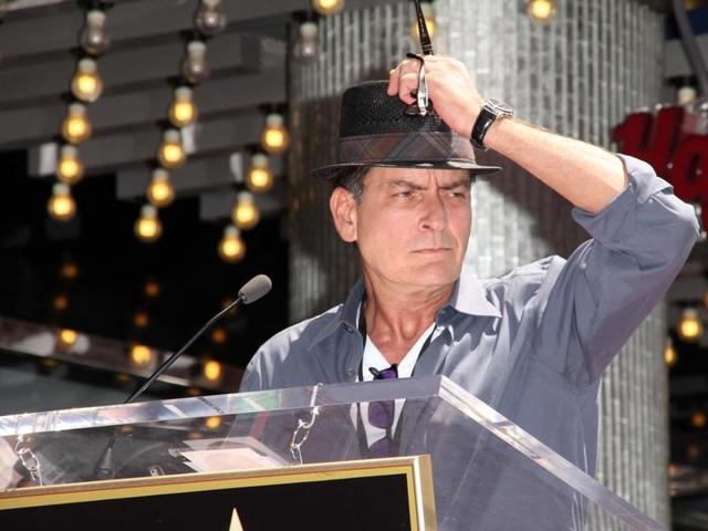 Actor Charlie Sheen pondering existence.