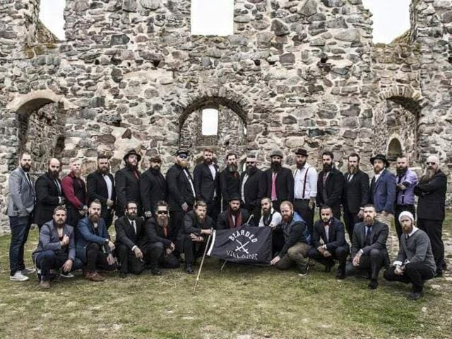 A club of bearded men posing for a photograph in the Swedish countryside with their black flag was mistaken for IS militants