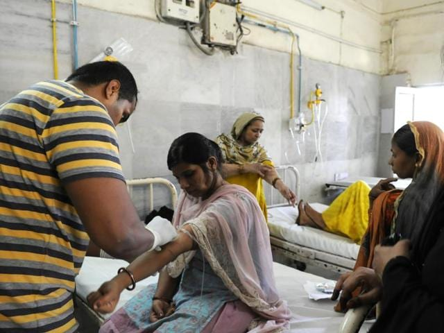 Patients at the Fever clinic of Kasturba Hospital undergo check up and blood test in New Delhi. This year's dengue outbreak in the capital is the worst in nearly two decades.