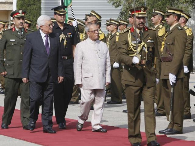 President Pranab Mukherjee reviews the guard of honour upon his arrival at the West Bank city of Ramallah on Monday.