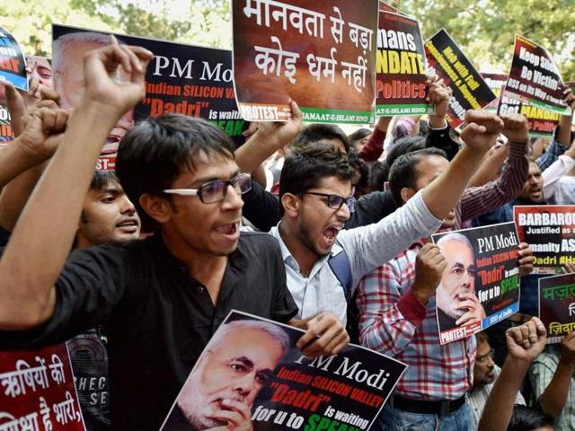 Muslim youth shouting slogans with placards during a protest against Dadri lynching incident, at Jantar Mantar in New Delhi.