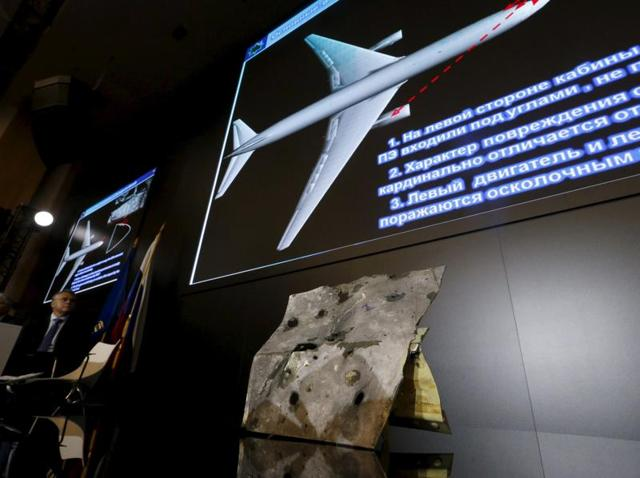 A sample and graphic materials are displayed during a news conference, organized by officials of Russian missile manufacturer Almaz-Antey and dedicated to the results of its investigation into Malaysia Airlines flight MH17 crash in eastern Ukraine, in Moscow, Russia, October 13, 2015.
