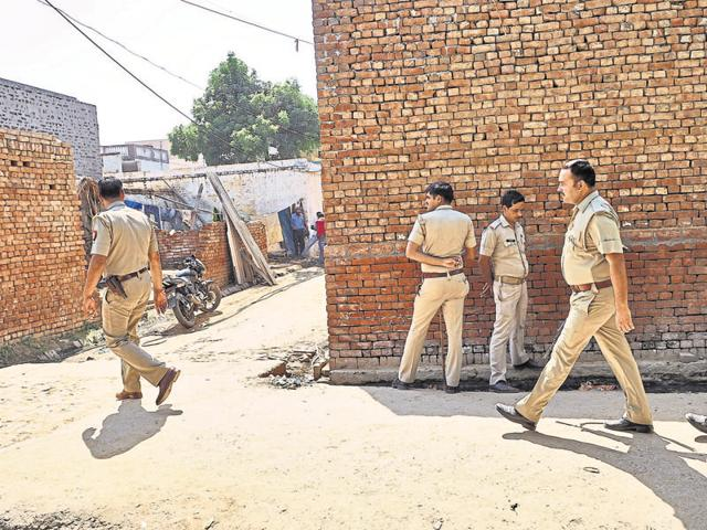 A police team patrols outside the house of Mohmmad Ikhlaq who was killed by a mob over allegations of cow slaughter.