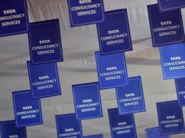 Logos of Tata Consultancy Services (TCS) are displayed at the venue of the annual general meeting of the software services provider in Mumbai in 2012.