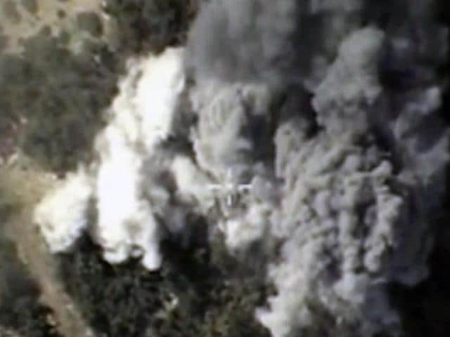A video grab made on October 13, 2015, shows an image taken from a footage made available on the Russian Defence Ministry's official website, purporting to show explosions after airstrikes carried out by Russian air force on what Russia says was an Islamic State ammunition depot in the Syrian province of Latakia.