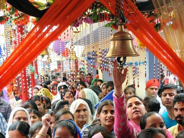 Devotees at the Babe Wali Mata temple at Bahu Fort in Jammu on Tuesday.