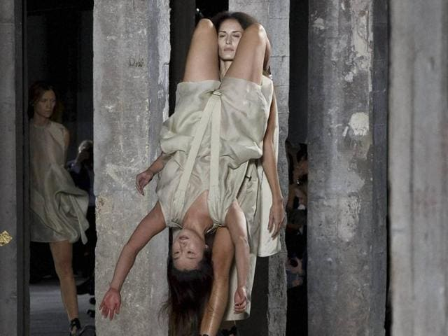 Models wear creations for American designer Rick Owens' as part of his Spring-Summer 2016 ready-to-wear fashion collection, presented during the Paris Fashion Week.