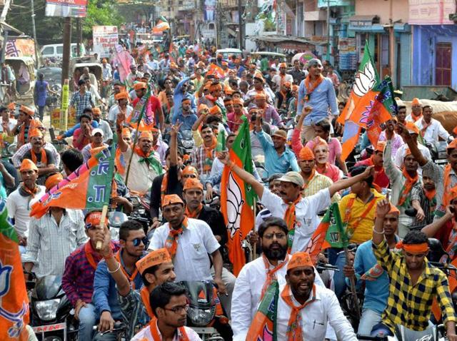 BJP workers take out a road show on the last day of election campaign in Gaya for the second phase of assembly elections.