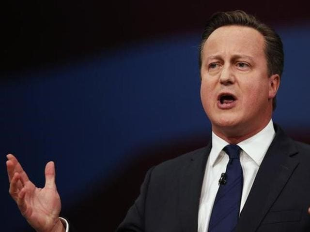 Britain's Prime Minister David Cameron gestures as he delivers his keynote address at the annual Conservative Party Conference in Manchester, Britain.