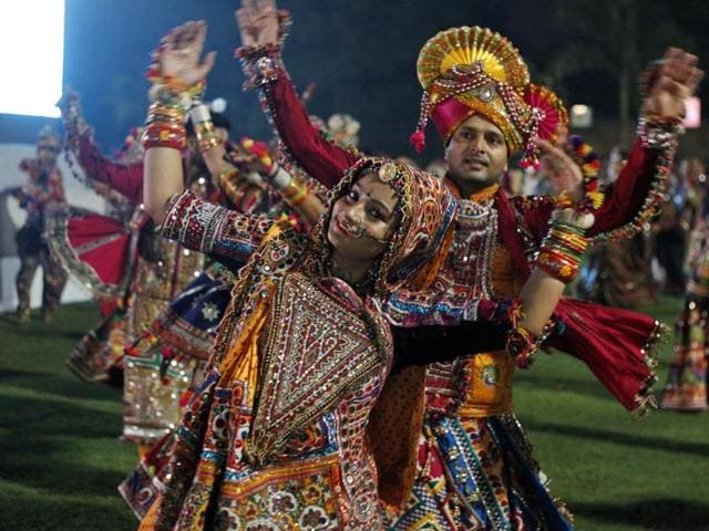 People perform garba during Navratri festival celebrations in Ahmedabad.