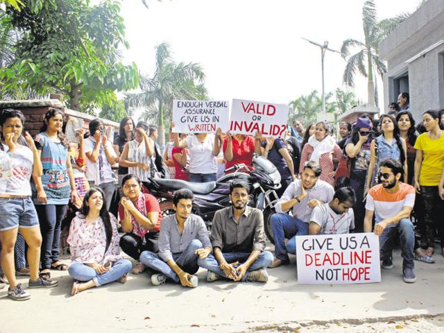 Seeking answers: FDDI Noida students sit on a dharna outside their campus.