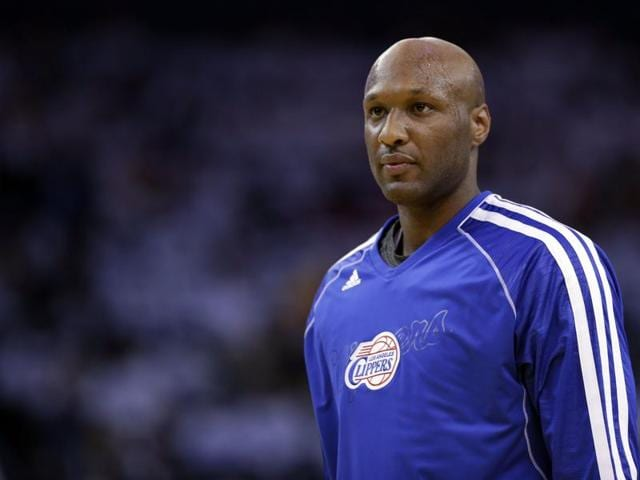 This Jan. 2, 2013 file photo shows Los Angeles Clippers' Lamar Odom (7) in action against the Golden State Warriors during an NBA basketball game in Oakland, California.