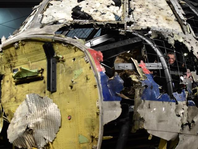 The wrecked cockipt of the Malaysia Airlines flight MH17 is presented to the press during a presentation of the final report on the cause of its crash at the Gilze Rijen airbase October 13, 2015.