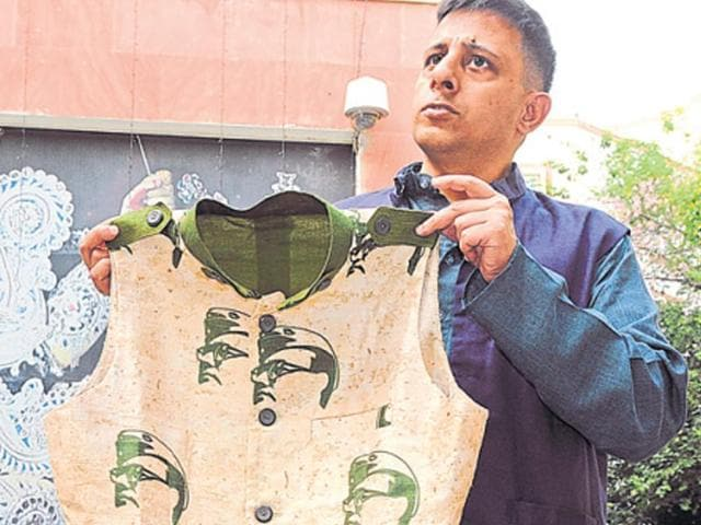 Anuj Dhar, a researcher on Netaji, shows a jacket presented to PM Modi on Wednesday.