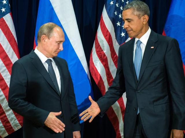 Russian President Valdimir Putin (L) and US President Barack Obama (R) shake hands for the cameras before the start of a bilateral meeting at the United Nations headquarters in New York City.