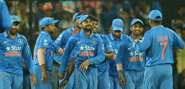 Teammates congratulate India's Virat Kohli for taking a catch to effect the dismissal of South Africa's Dale Steyn during the second one day international .