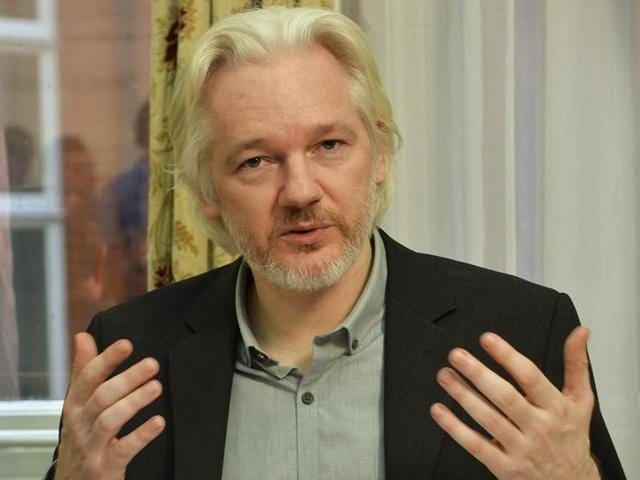 WikiLeaks founder Julian Assange gestures during a news conference at the Ecuadorian embassy in central London, Britain.
