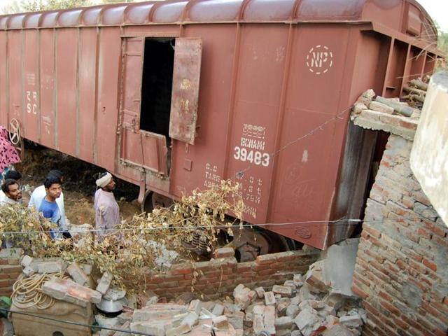A goods train rams into a private house after derailment near Sangrur on Thursday.