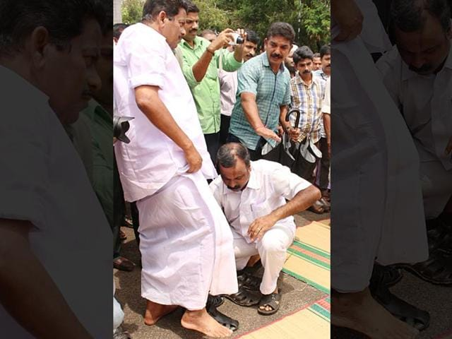 In this video clipping, N Sakthan's driver is seen helping him take off his slippers at a function in Kerala.