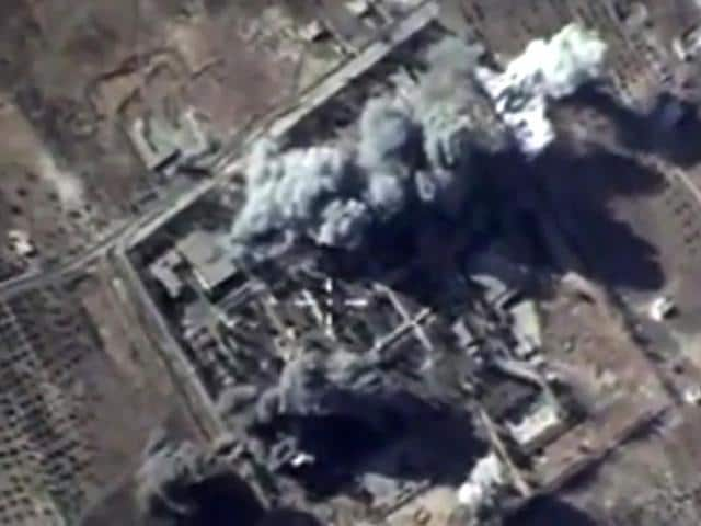 A video grab shows an image taken from a footage made available on the Russian Defence Ministry's official website, purporting to show explosions after airstrikes carried out by Russian air force on what Russia says was an Islamic State training camp in the Syrian province of Idlib.