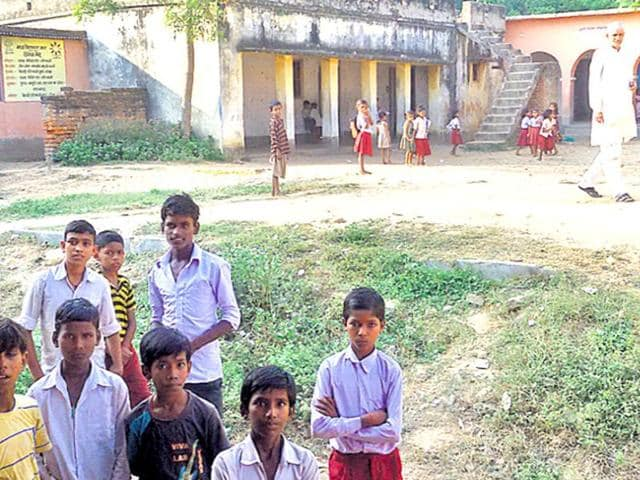Students at a school in Laxmanpur Bathe village in Arawal district of Bihar. The hurly-burly of poll barely hides caste tensions that may hide the winner .