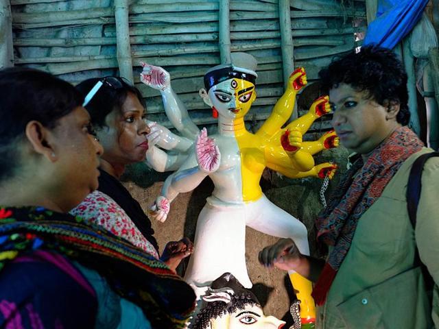 Transgenders with Ardhanarishwar Durga idol at China Pal's studio in Kolkata.