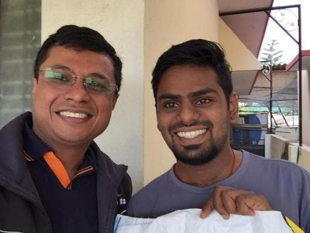 Flipkart co-founder Sachin Bansal poses with a customer after making a delivery.