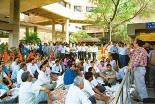 The traders held a protest against the ongoing door-to-door survey by the UT excise and taxation department in the Industrial Area on Friday.