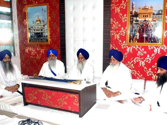 Five Sikh high priests holding a meeting at Akal Takht secretariat at Golden Temple in Amritsar on Friday.