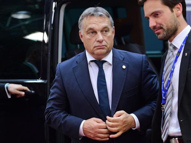 Hungarian Prime Minister Viktor Orban arrives to take part in a European Union (EU) summit dominated by the migration crisis at the European Council in Brussels.