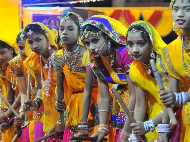 Girls dance to garba tunes at a programme in Indore.