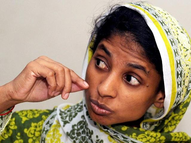 Geeta, a deaf and mute Indian girl, tells her story through her own form of sign language at a charity in Karachi.
