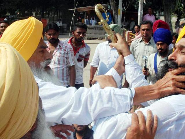 Takht Damdama Sahib former head priest Balwant Singh Nandgarh (left) in an altercation with SAD (Amritsar) leader Parminder Singh Balianwali during a protest on Goniana road in Bathinda on Thursday.