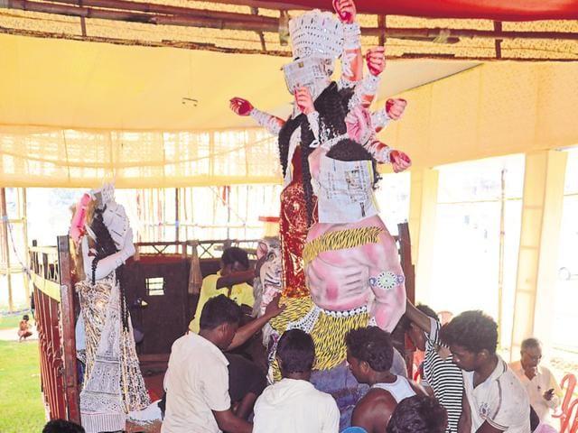 An idol of Durga being taken to a puja pandal in Bokaro on Thursday.