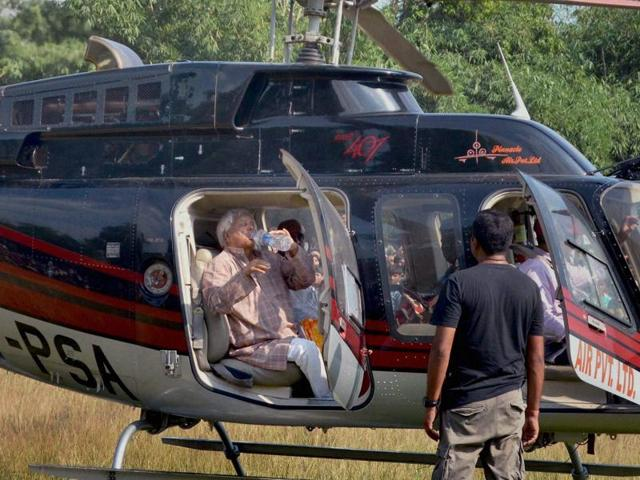 RJD chief Lalu Prasad leaves in a chopper after addressing an election rally at Lakhaura in Motihari on Friday.