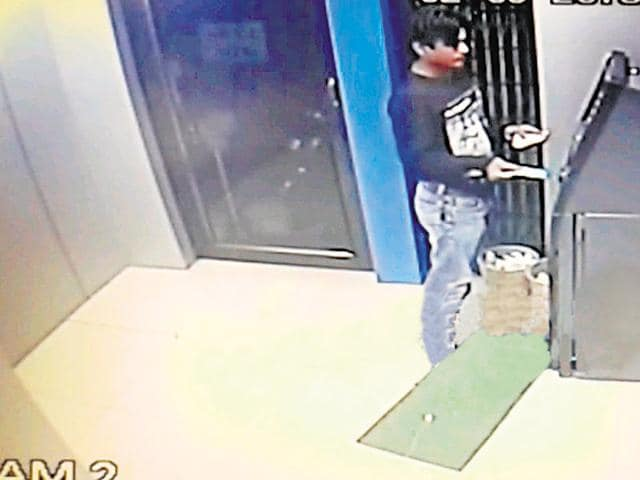 A screengrab from a Byculla ATM security camera footage shows the suspect making a withdrawal.