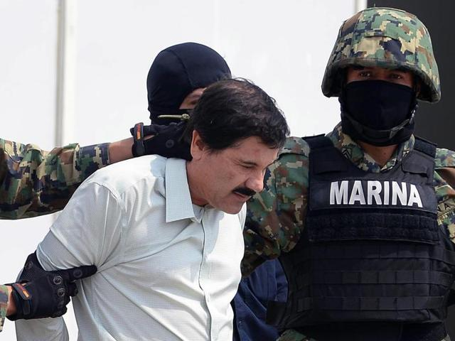 "Mexican drug trafficker Joaquin ""El Chapo"" Guzman, seen here in the custody of Mexican marines. The Sinaloa cartel boss was injured during an unsuccessful attempt to recapture him."
