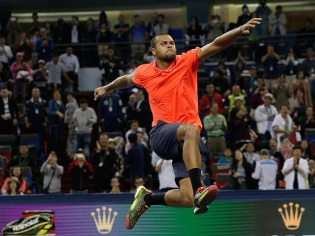 Jo-Wilfried Tsonga of France dives to return a shot against Rafael Nadal of Spain during their semifinal match of the Shanghai Masters tennis tournament in Shanghai, China. (AP Photo)
