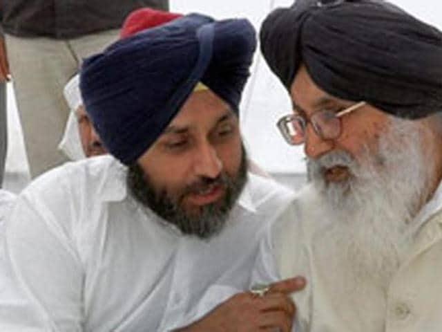 Punjab deputy CM Sukhbir Singh Badal with CM Parkash Singh Badal. HT Photo