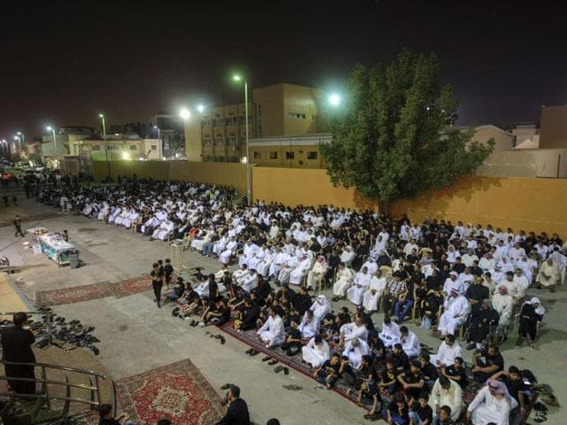 Saudi Shiite worshipers gather in a hussainiya, a Shiite hall used for commemorations, in the mainly Shiite coastal town of Qatif. A gunman opened fire at a Shiite gathering in eastern Saudi Arabia, killing five people before being gunned down.