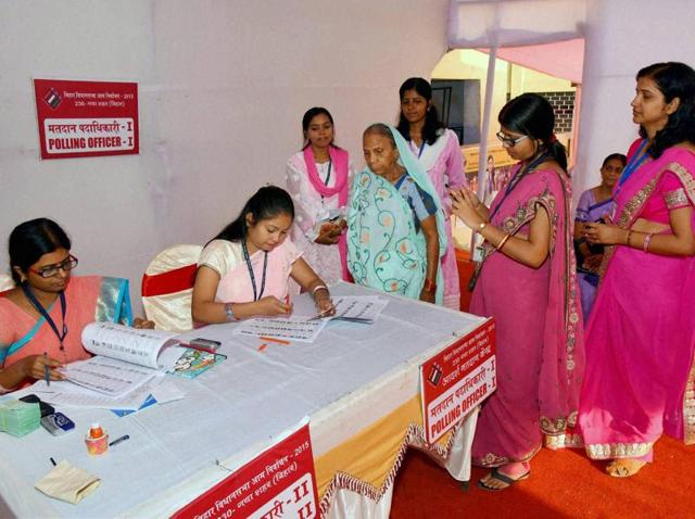 Women poll officials assist voters at a model polling station in Gaya during second phase of Bihar assembly elections.