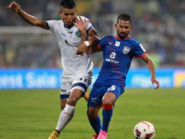 Pratesh Shirodkar of Mumbai City FC (R) in action against Thoi Singh of Chennaiyin FC ( L) during the 5th match of Hero Indian Super League at DY Patil Stadium, New Mumbai.